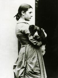 Beatrix Potter at fifteen years with her springer spaniel, Spot